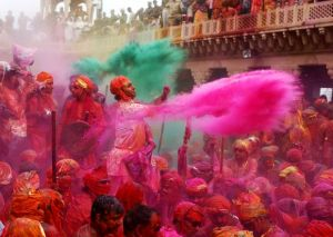 "People throw coloured powder as they celebrate ""Lathmar Holi"" at Nandgaon village"